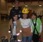 Firefighter, Billy Nonemaker, and kids