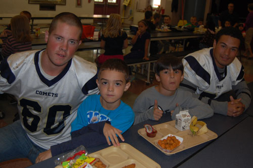 Penn Manor High School football players are spreading the message to elementary students that reading is important