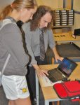 Charlie Reisinger instructs a student on their new laptop