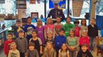 Carlos Marcelino poses with students in Patty Detter's first-grade classroom at Eshleman Elementary.