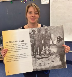 """Jenny Steffy, an art teacher at Martic and Letort Elementary Schools, holds the iconic photo of her uncle she recently discovered in a children's book titled """"Veterans Day."""""""