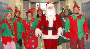 Staff dress up as elves and Santa