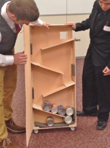 Students Mitch Haag and Alexander Thomas display the inner workings of the device they designed and built.