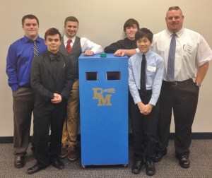 Students pose with their portable food bank and teacher Barry Groff