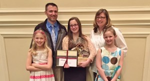 Manor MS eighth-grader Peyton Cassel at the awards ceremony with, from left, sisters Emma and Mackenzie and parent Steve and Jennifer Cassel.