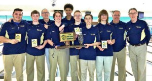 PMHS bowlers and coaches hoist the state trophy.