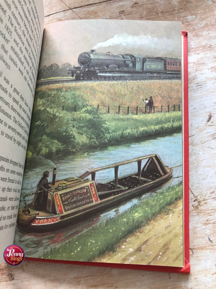 A picture from The Story of Our Canals showing a canal boat in the foreground and a steam train in the distance.