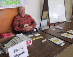 Happy Volunteer at the Front Table
