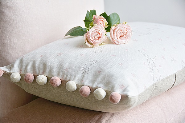 rabbit all star oblong cushions side trimmed with pink and ivory pom poms 60 00 peony sage
