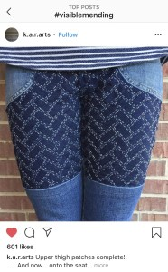 Visible mending on jeans