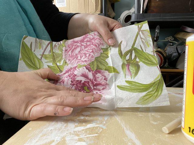 gently lay napkin on the decoupage glue