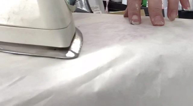 Iron the paper in place