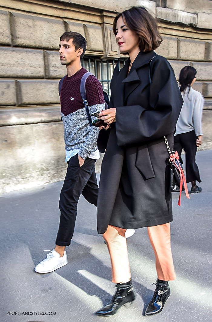What urban couples are wearing, what are people wearing in paris? street style Paris, male black grey clothing style, White sneakers with black classic pants, sweater layered over white shirt outfit Lacoste men's fashion pintrest