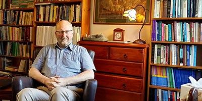 John in his office