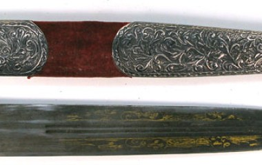 Armenian kindjal dagger with ivory grip, silver mountings, and a gold inscribed blade.