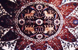 A close-up of the Armenian Orphan Rug with its intricate detail bearing colorful images of animals akin to the Garden of Eden. The rug was woven in 1924-25 and presented to President Calvin Coolidge. It now lies in storage inside the White House.
