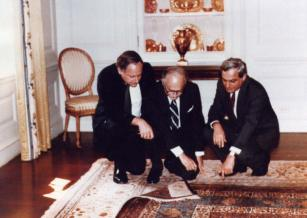 The Armenian Orphan Rug is viewed inside the White House in September 1984 by activists looking to preserve its identity. (L-R) U. S. Senator Carl Levin (D-Mich.), Dr. H. Martin Deranian, Worcester historian, and Set Momjian, a former ambassador to the United Nations.