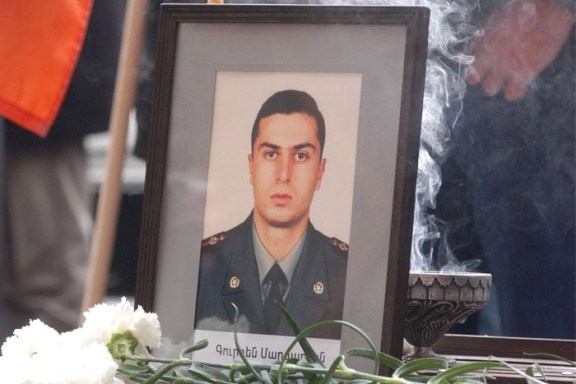 The funeral of Lieutenant Gurgen Markarian, an Armenian army officer who was axe-murdered by an Azerbaijani colleague during a NATO training course in Budapest, 25 February 2004.