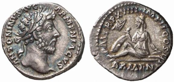 Left portrait of Lucius Verus AD 161-169, right: Armenia seated on the ground in attitude of mourning.