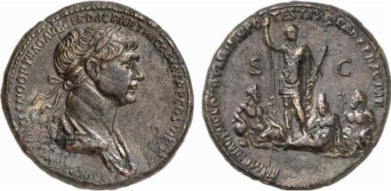 Trajan in military attire standing, holding spear and parazonium, at his feet are the reclining figures of Armenia symbolically placed between Euphrates and Tigris (as a geographical reminder) reffering to anexation of Armenia.