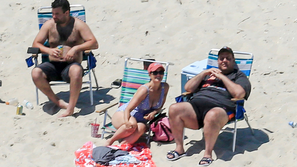 Chris Christie sunbathes after fleecing New Jersey's residents