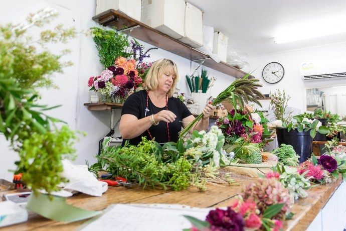 The studio of Fiona from Flowersmith Flowers is full of colourful flowers.