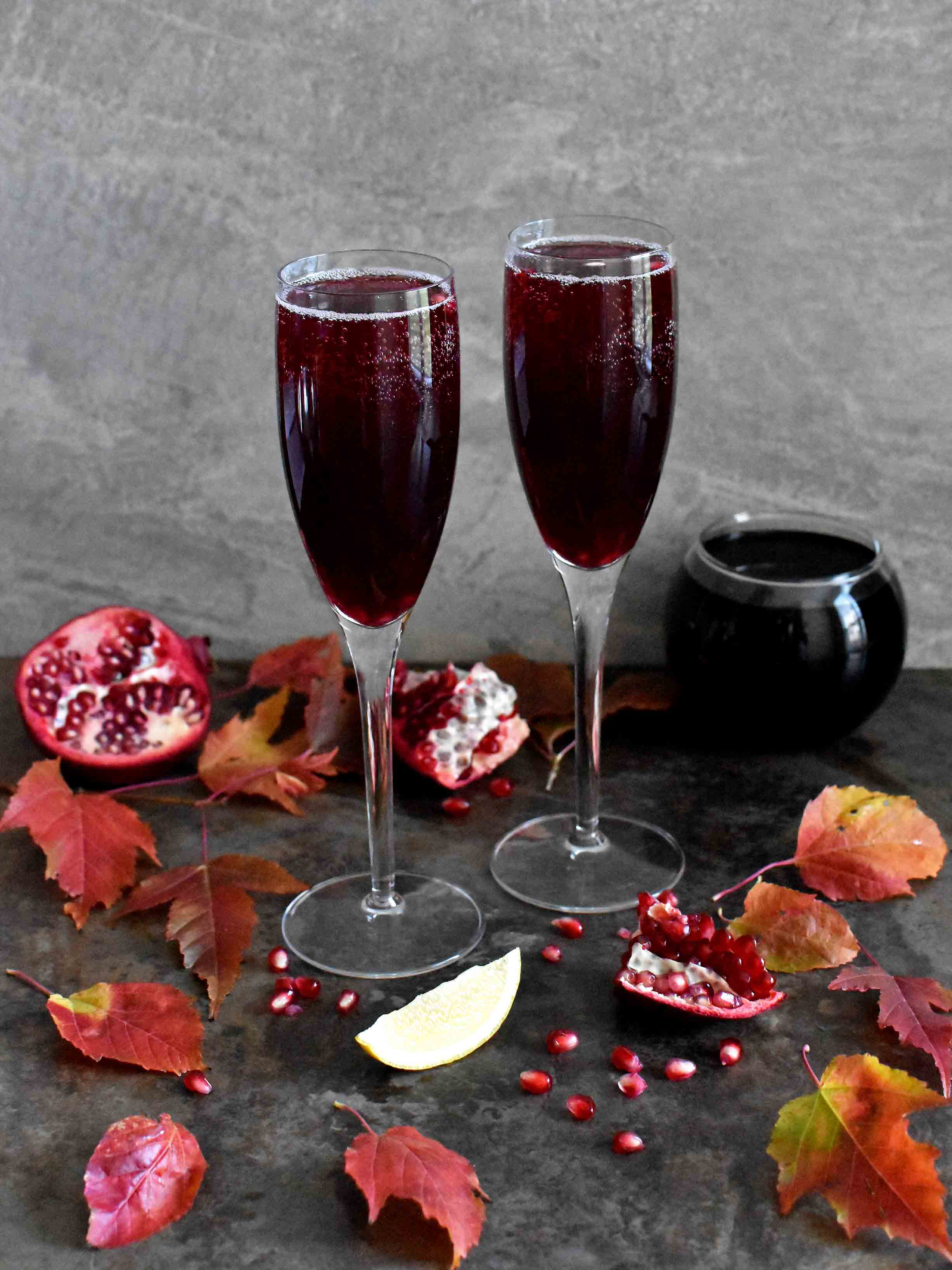 Pomegranate Champagne Cocktail - Pepper Delight #pepperdelightblog #recipe #cocktail #thanksgiving #pomegranate #champagne #drinks #newyear #christmas #holidaydrinks #5minuterecipes #party #festivals