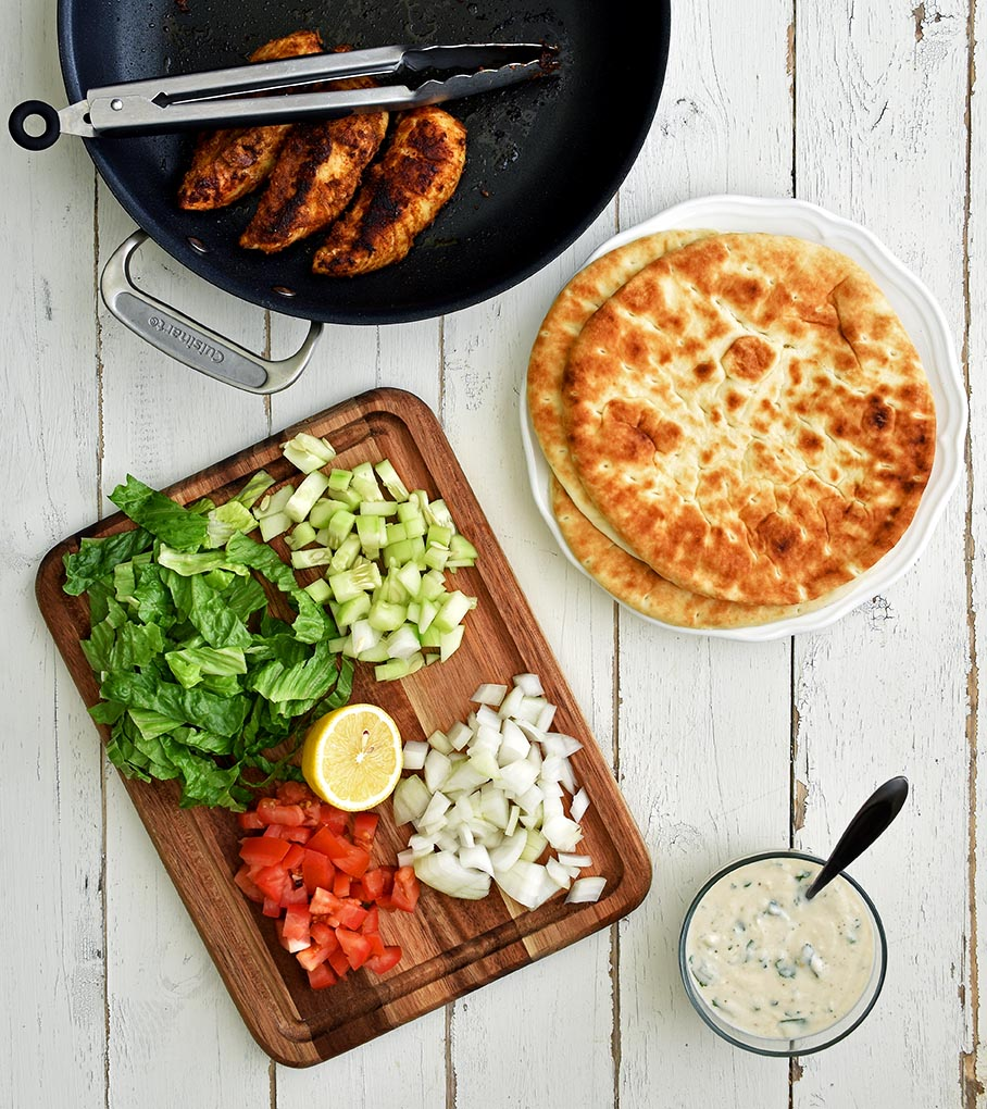 Mediterranean Chicken Pita Wraps with Cilantro Tahini Sauce - Pepper Delight #pepperdelightblog #recipe #chickenpitawraps #wrap #dip #pitawrap #arabic #middleeast #tahinisauce #mediterranean #leftovertahinisauce #celebration #holiday #gameday #yogurtsauce #healthy #quick #greek #gyro