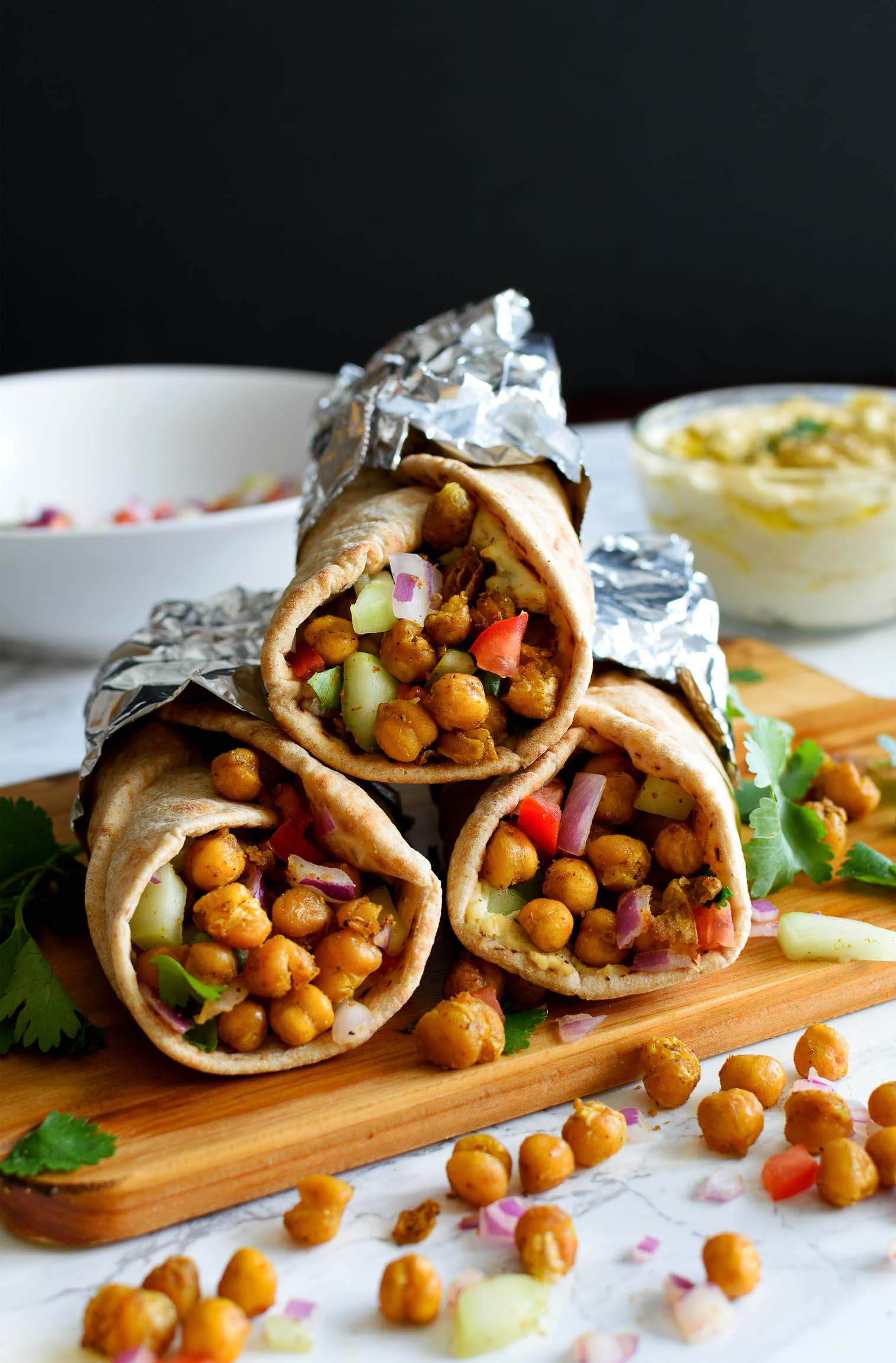 Roasted Chickpeas Hummus Wrap - Pepper Delight #pepperdelightblog #wrap #roll #vegetarianwrap #chickpeaswrap #hummuswrap #pitawrap #hummus #classichummus #appetizer #christmas #celebration #party #gameday #vegetarian #arabic #mediterranean #dip #glutenfree #garammasala #chickpeas #meatlessrecipe