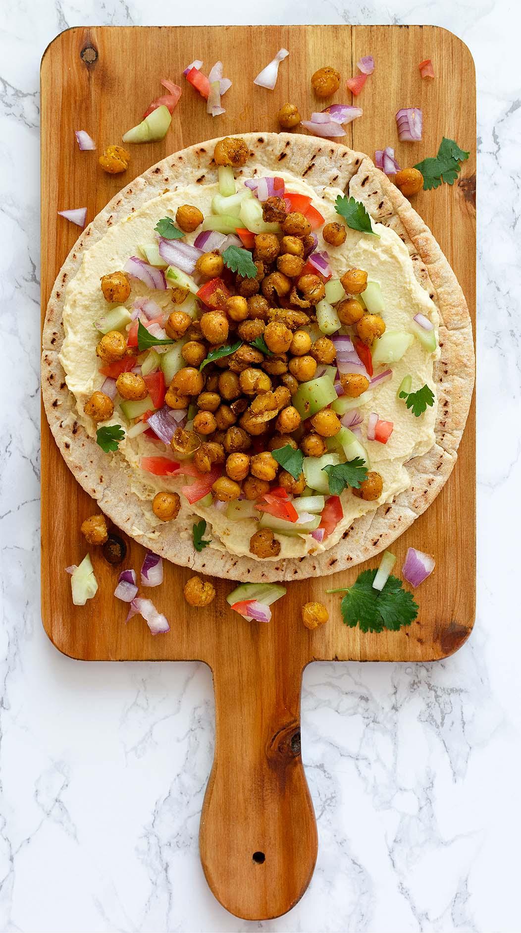 Roasted Chickpeas Hummus Wrap - Pepper Delight #pepperdelightblog #wrap #roll #vegetarianwrap #chickpeaswrap #hummuswrap #pitawrap #hummus #classichummus #appetizer #christmas #celebration #party #gameday #vegetarian #arabic #mediterranean #dip #glutenfree #garammasala #chickpeas #meatlessrecipe