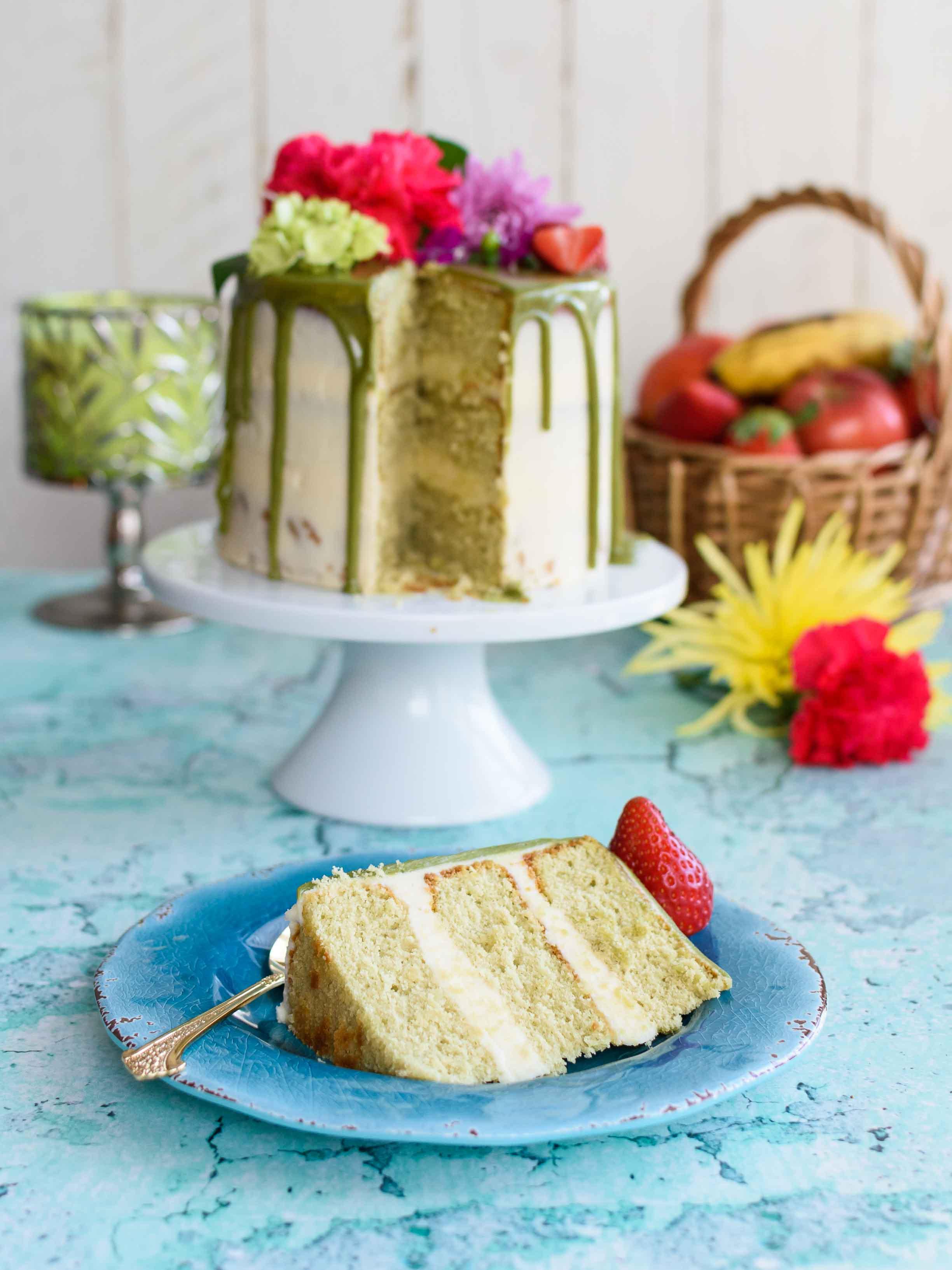 Matcha Cake with Buttercream Frosting and White Chocolate Matcha Drip - Pepper Delight #pepperdelightblog #recipe #cake #matchacake #greenteacake #birthdaycake #celebration #christmas #dessert #birthday #buttercream #party #matcha #japanesecake #seminakedcake #nakedcake #matchaganache #whitechocolateganache #bloganniversary #baking #kitchenaidusa