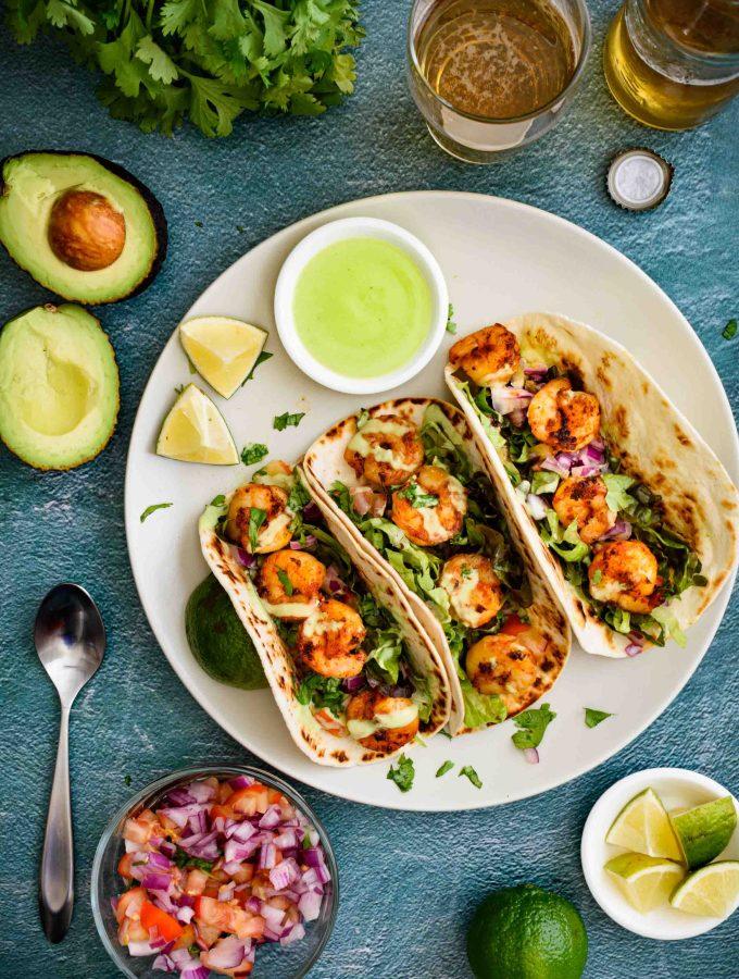 shrimp tacos with pico de gallo and avocado yogurt sauce