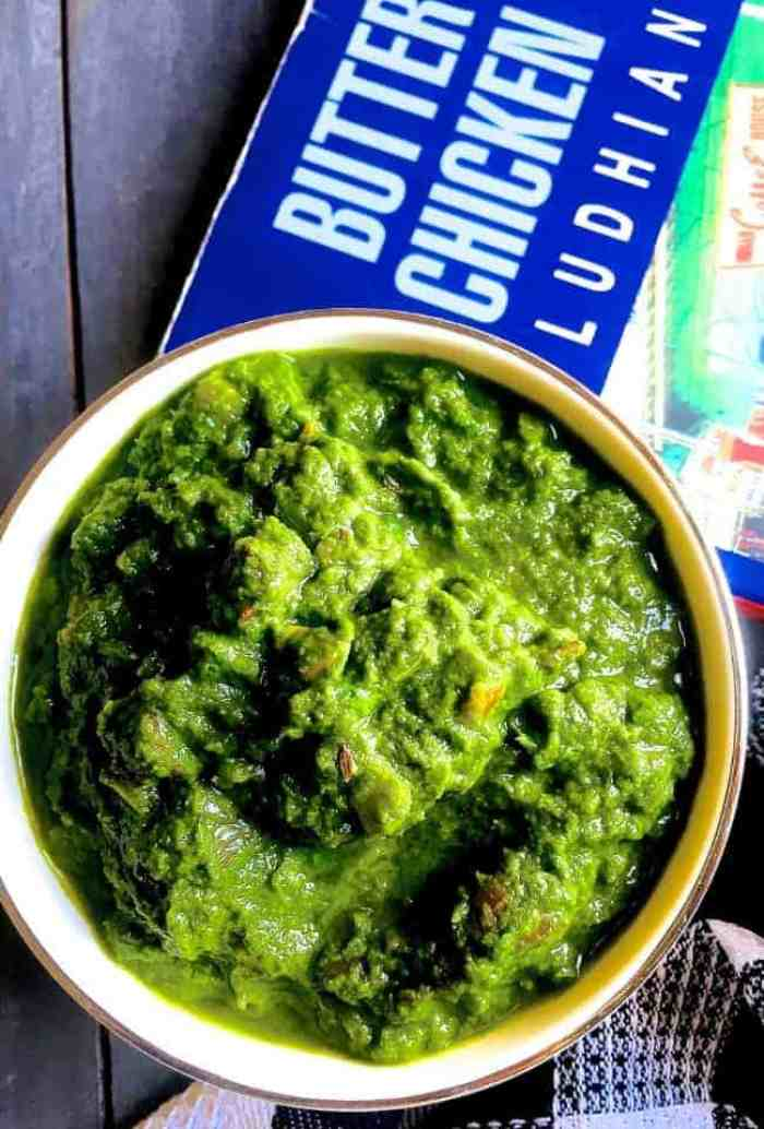A bowl of mustard greens the traditional sarson ka saag, cooked in onions and tomatoes