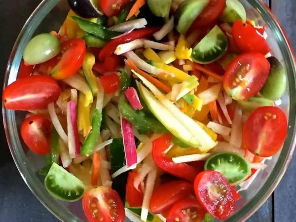 Salad of Radish Tomato Raw Mango in a citrusy ginger dressing