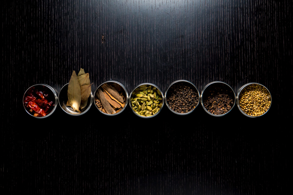 basic indian spices - row of spices in bowls