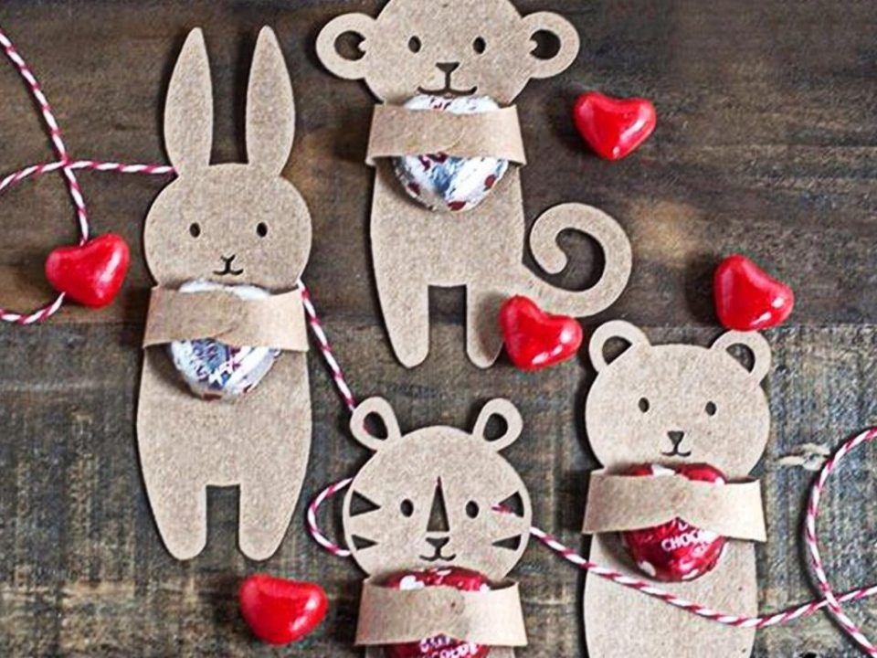 Cardboard animal characters holding single pieces of candy - Valentines day crafts