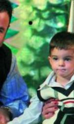 Adrian Enache,  Iuliana Marciuc și David, când era mic