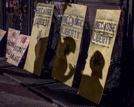 Shadows of protesters on make-shift shields.
