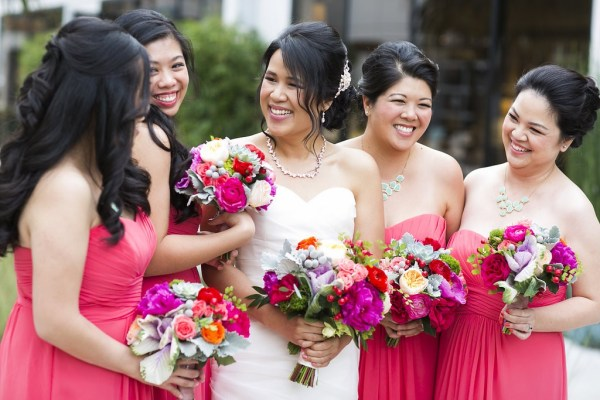 coral pink bridesmaids dresses with colorful bouquets
