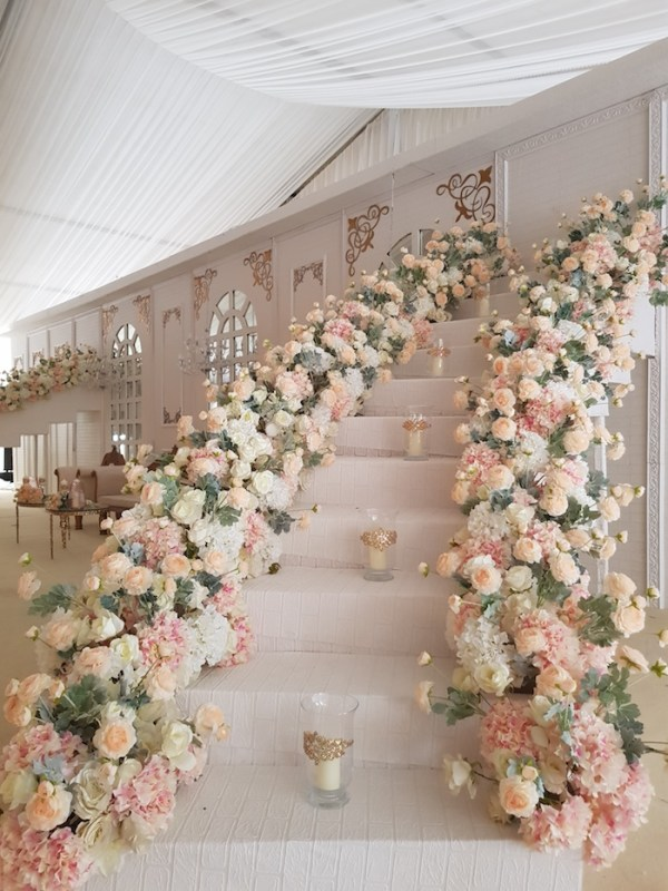 floral wrapped stairway