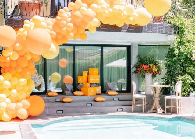 Pool baby shower with balloon garland decor
