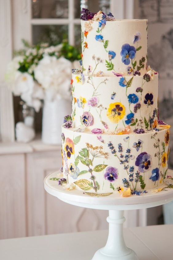 white spring wedding cake with flowers