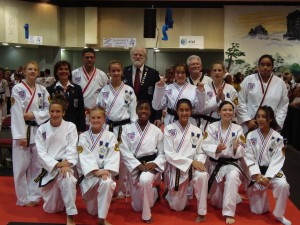 Ms. Johnson (kneeling center) and Sparring Competitors from her 2nd Degree Black Belt Girls Division Worlds 2009
