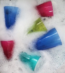 glasses in soapy water