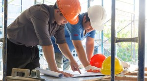 Men planning to build construction project
