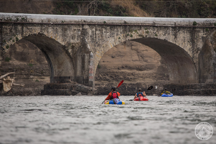 Packrafting towards a bridge on the Rio Antigua