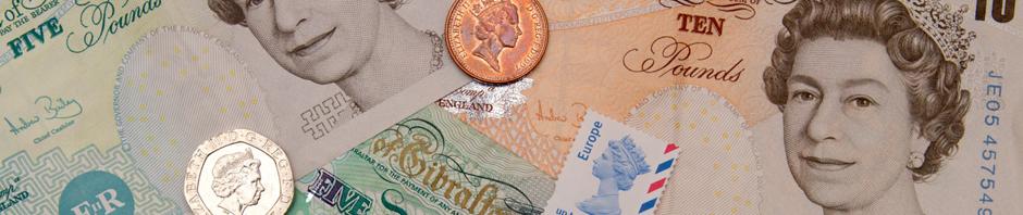Billetes monedas y sellos con efigies de Isabel II