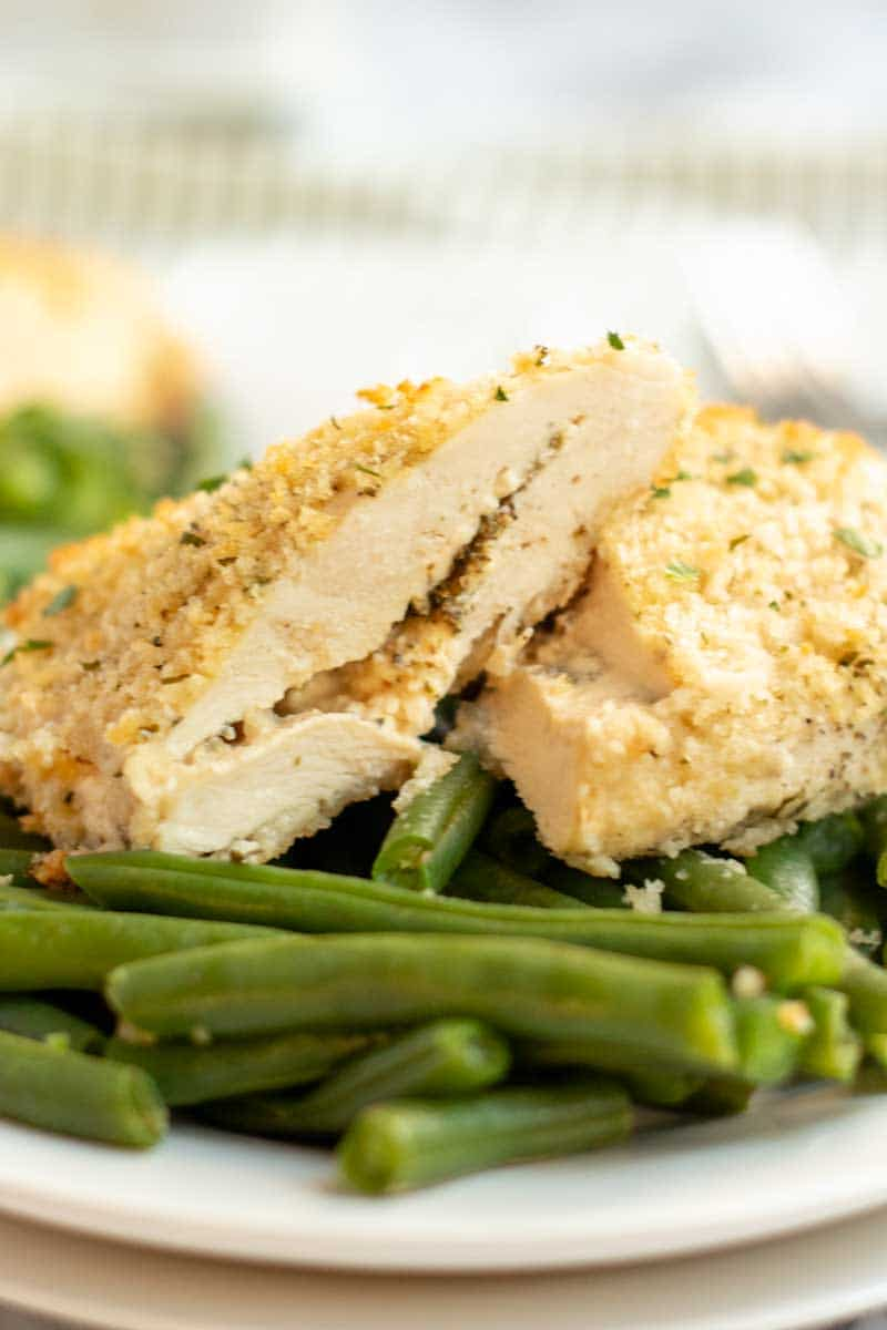 Laughing Cow Chicken is a lightened up version of a stuffed chicken breast. This super easy, 5 ingredient dinner will please your picky eaters and wow your foodies. | www.persnicketyplates.com