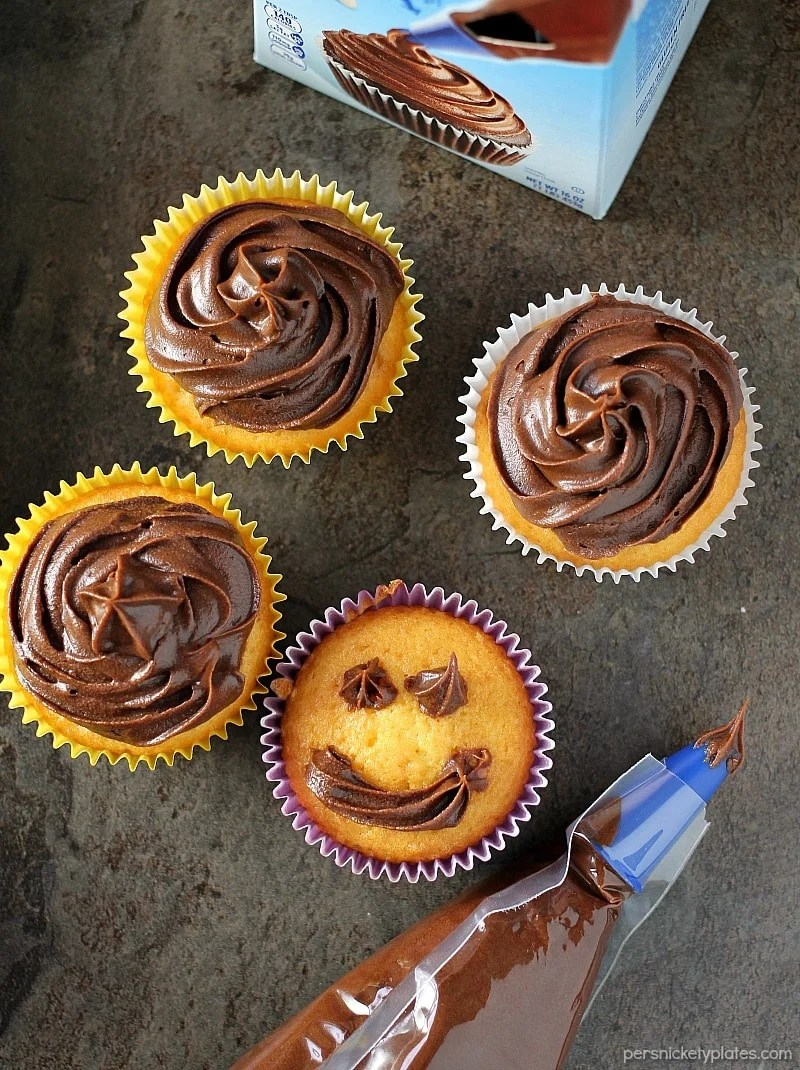 Cheesecake Filled Cupcakes are super simple starting with a cake mix but filled with chocolate chip cheesecake mixture in the centers!   www.persnicketyplates.com