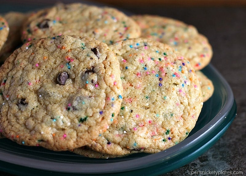 These Perfect Party Cookies start with a cake mix and are full of chocolate chips and sprinkles. Mix up the colors to suit whatever type of party you're having!   Persnickety Plates
